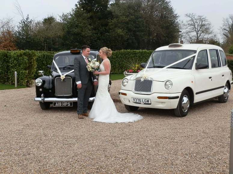 Bride & Groom with London Taxi Wedding Cars at Nottingham Golf and Country Club