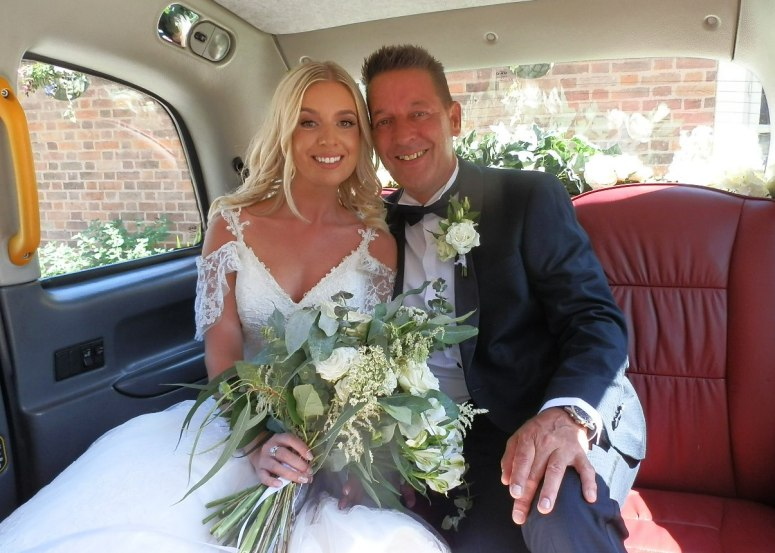 Bride and Father in London Taxi Wedding Car at Clumber Park Hotel