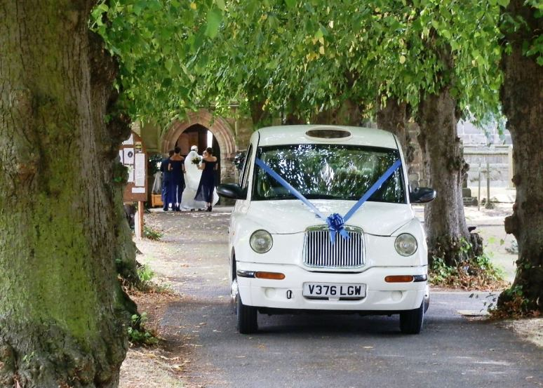 London Taxi Wedding car at Church in Sawley Long Eaton