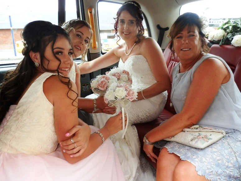 Bridal Party in London Taxi Wedding car