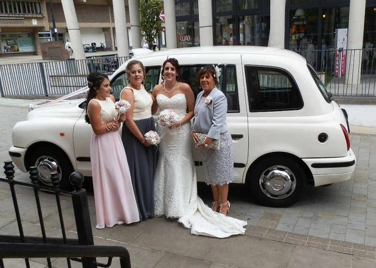 Bridal Party by London Taxi Wedding Car at Royal oak House Derby