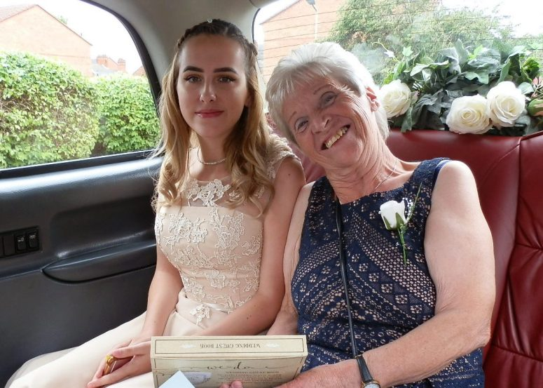Bridesmaid and Mother of the Bride in London Taxi Wedding Car at Loughborough Register Office