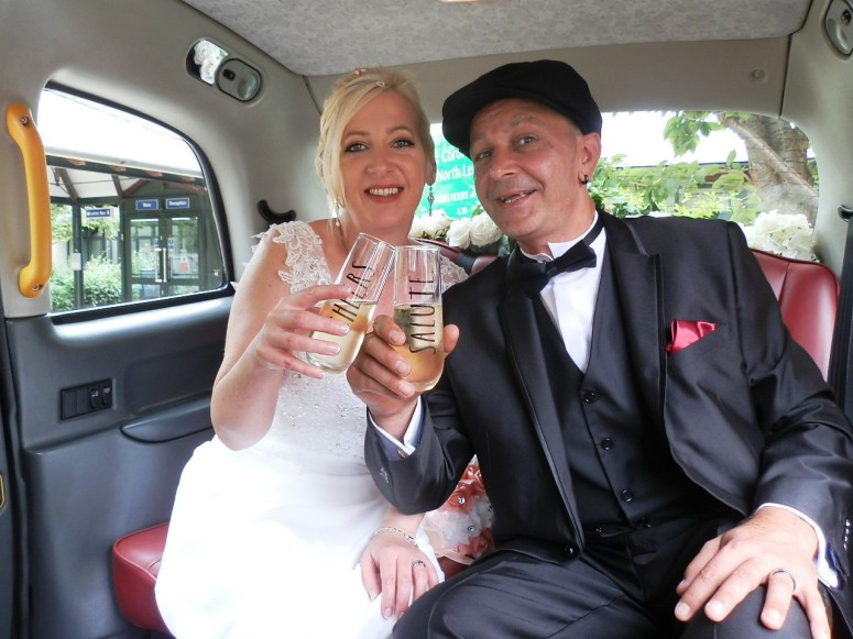 Bride and Groom in rear of London Taxi Wedding Car for Peaky Blinders themed wedding