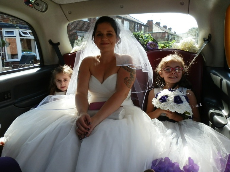 Bride and here children in London Taxi Wedding Car at The Village Hotel Chilwell