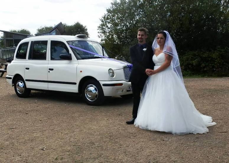 Bride and Groom by London Taxi Wedding Car at Attenborough Nature Reserve