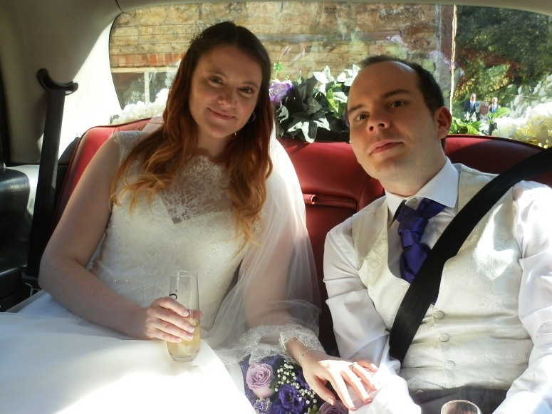 Bride and Groom in London Taxi Wedding Car at Hackthorn Hall Estate