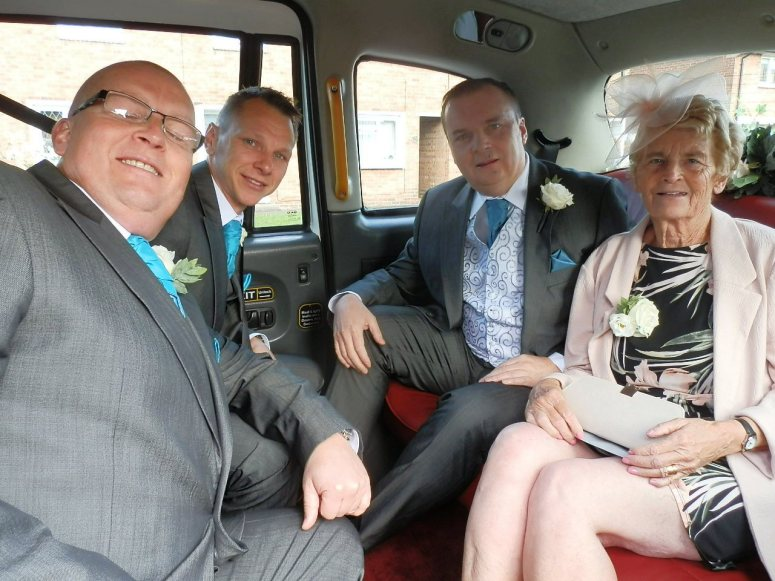 The Groom and his party in the rear of a London Taxi Wedding Car at Mapperley Farm