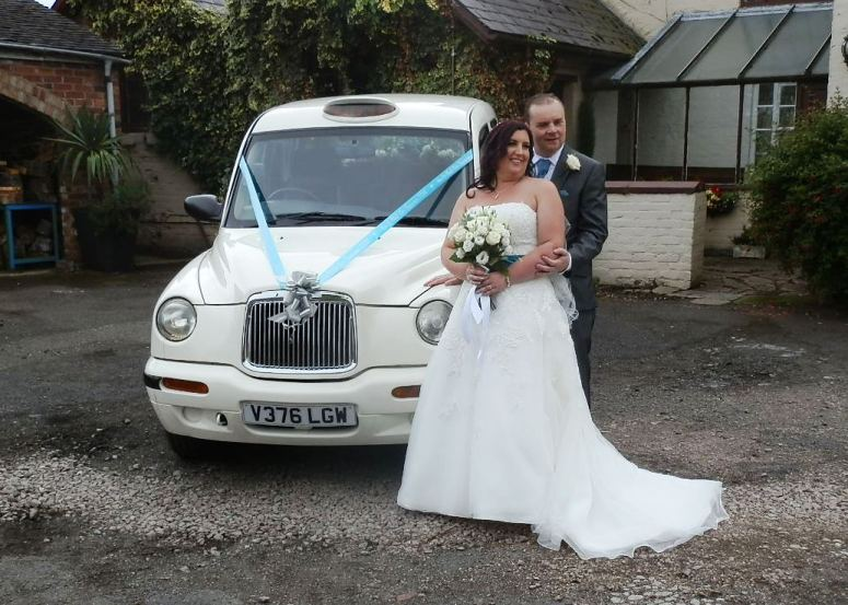 Bride and Groom outside London Taxi Wedding Car at Mapperley Farm