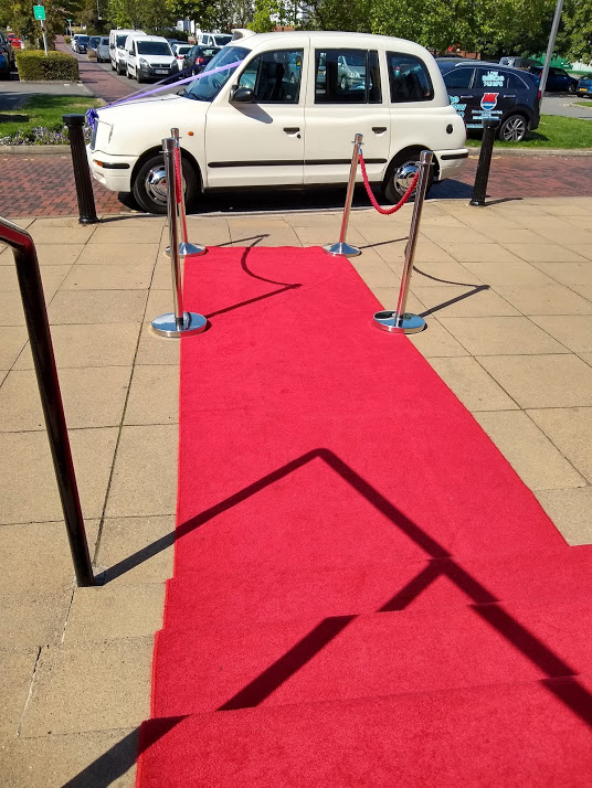 London Taxi Wedding Car by the red carpet at The Village Hotel Chilwell