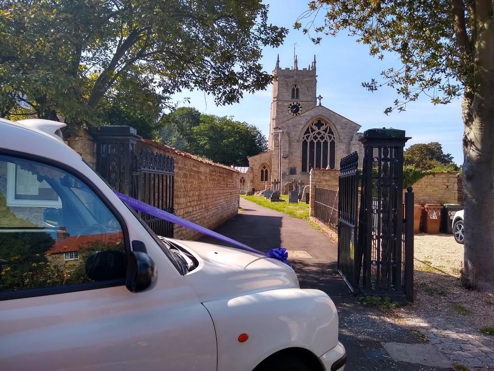 London Taxi Wedding Car outside Church in Lincolnshire