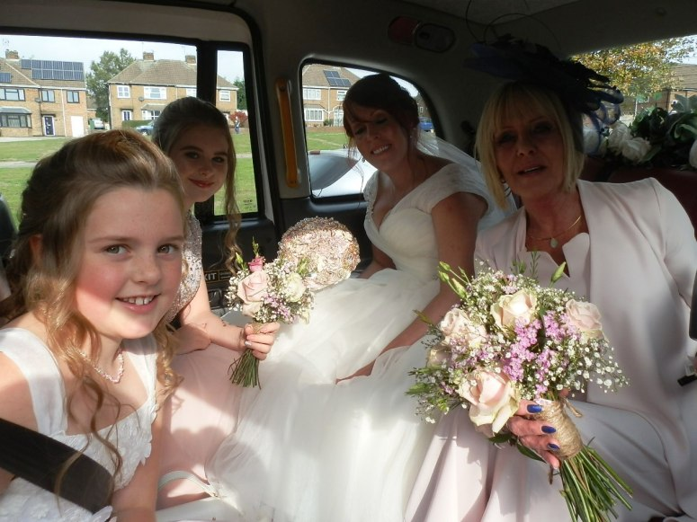 Bridal party in rear of London Taxi Wedding Car