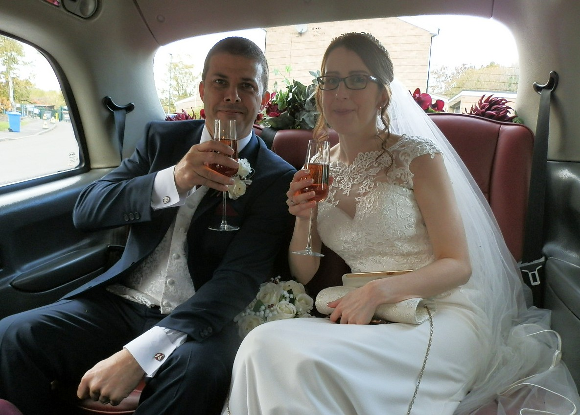 Bride and Groom in rear of London Taxi Wedding Car