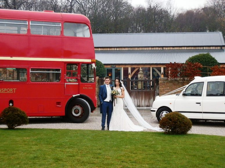Bride and Groom with a London Bus and London Taxi Wedding Car at Hazel Gap Barn