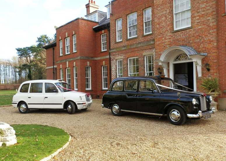 Two London Taxi Wedding Cars at Woodhall Spa