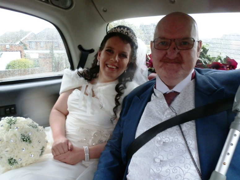 Bride and Father in rear of London Taxi Wedding Car at Eastwood Hall