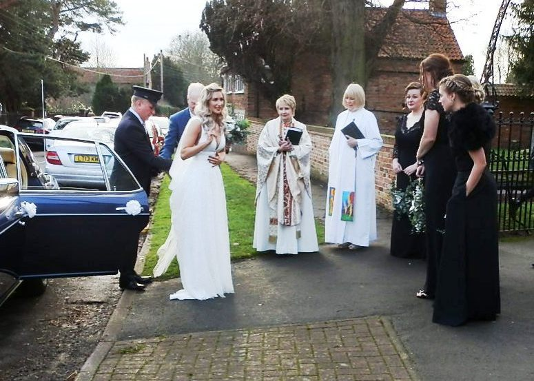 Bride and her party outside Church