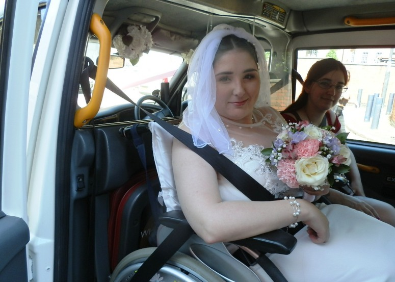 Bride in a wheelchair in a London Taxi Wedding Car