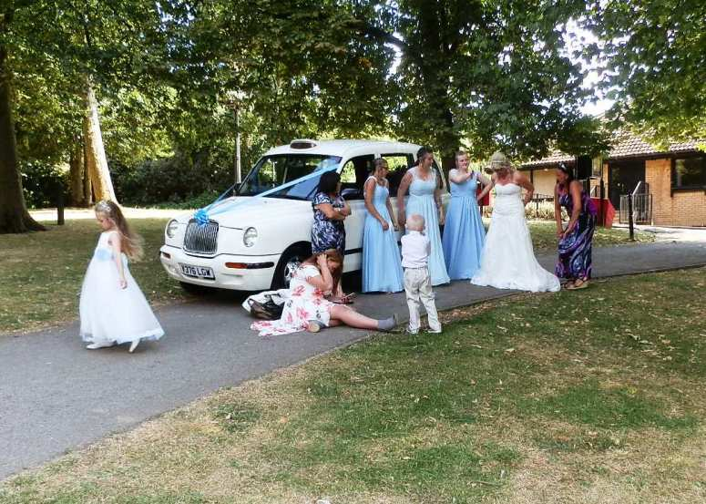 Bridal party outside London Taxi Wedding Car at Arnot Hill House