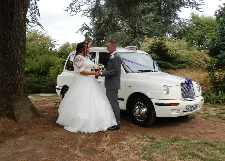 Bride and Groom outside London Taxi Wedding Car at Quorn Grange Hotel
