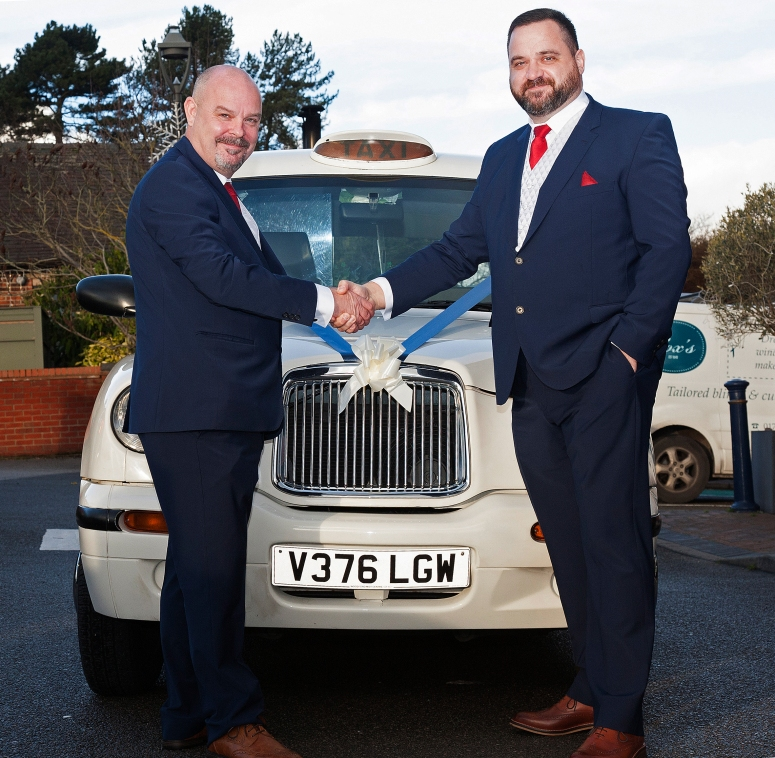 Groom and Best Man outside London Taxi Wedding Car at Morley Hayes