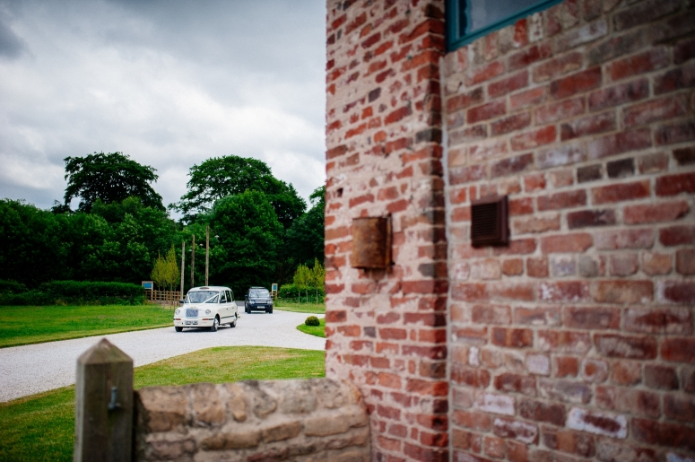 London Taxi Wedding Car arriving at Hazel Gap Barn