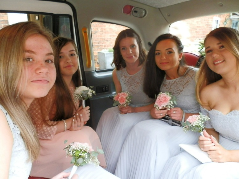Five Bridesmaids in rear of London Taxi Wedding Car at The Coleshill Hotel