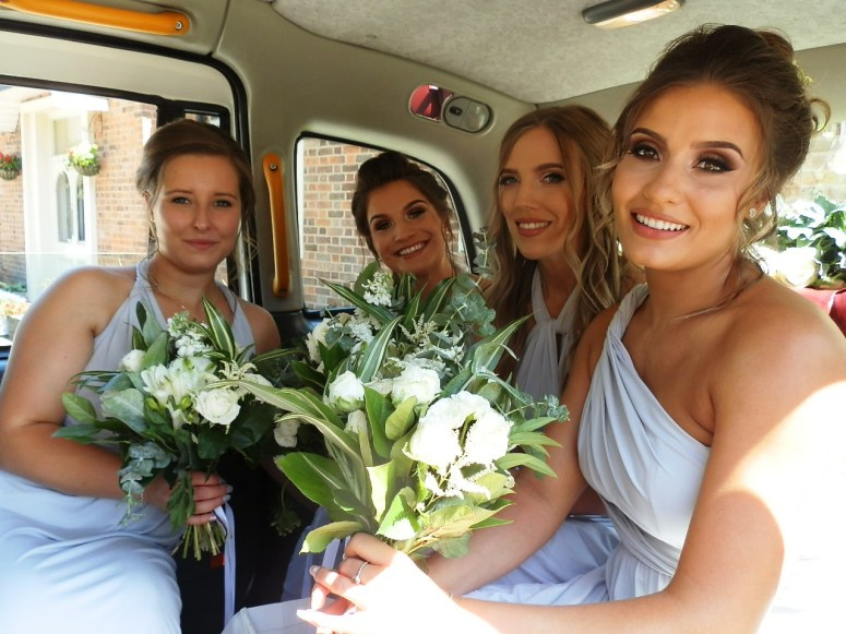 Four Bridesmaids in rear of London Taxi Wedding Car