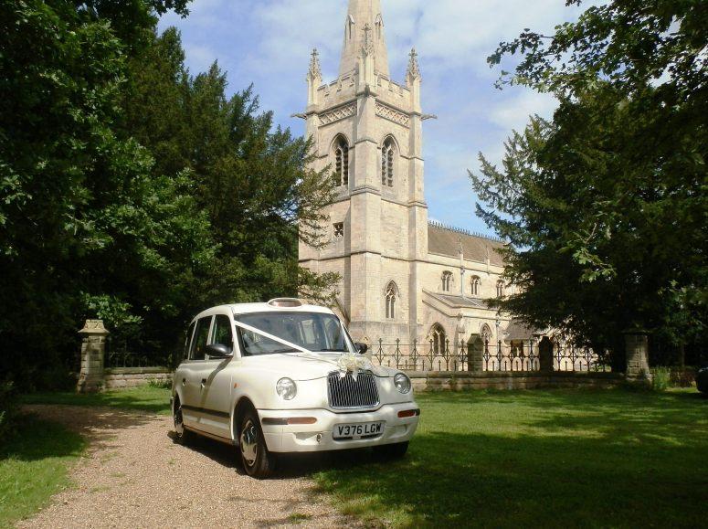 London Taxi Wedding car outside St John's Church, Perlethorpe