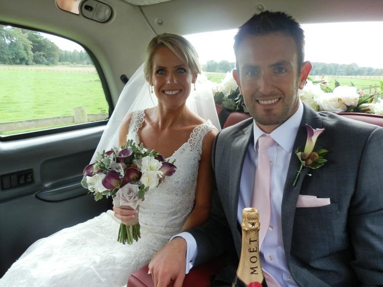 bride and Groom in London Taxi Wedding Car at St John's Church Perlethorpe