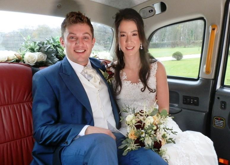 Bride and Groom in London Taxi Wedding Car at Hazel Gap Barn