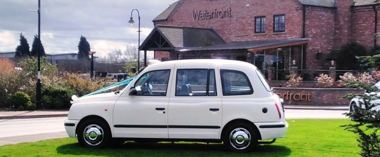 London Taxi wedding car in front of the Waterfront pub at Barton Marina