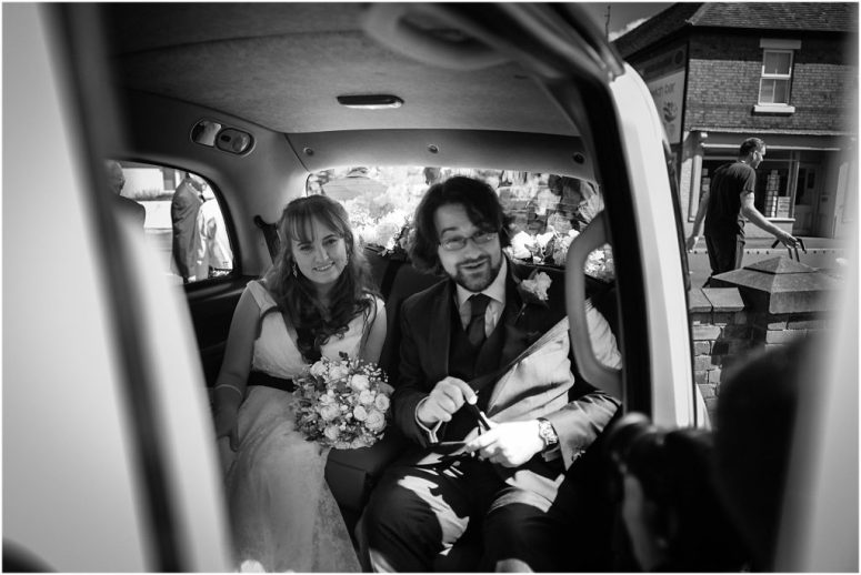 Bride & Groom in London Taxi Wedding Car