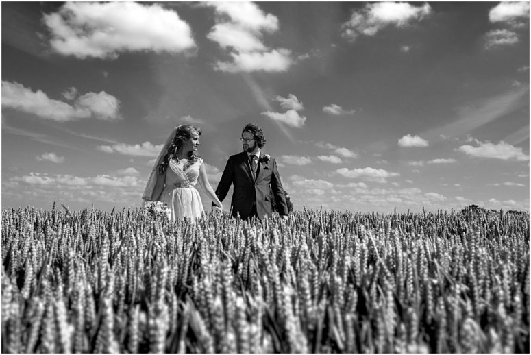 Bride and Groom in wheat field by the Crow's Nest Barton Marina